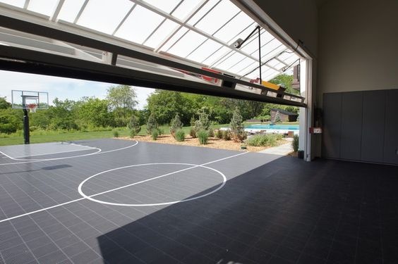 Outdoor basketball hoop home gym transitional with garage for Indoor basketball court installation