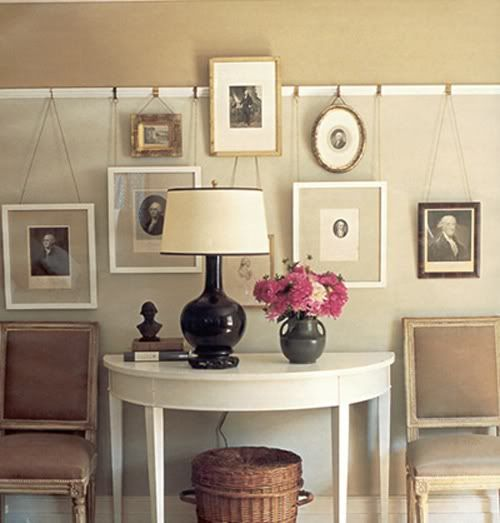 We have an older home ('25) with picture rail molding and plaster walls (you can't put nails in the walls). We have to hang things just like in this picture with picture rail hooks. I just ordered our hooks today! Little Green Notebook: Picture rails.