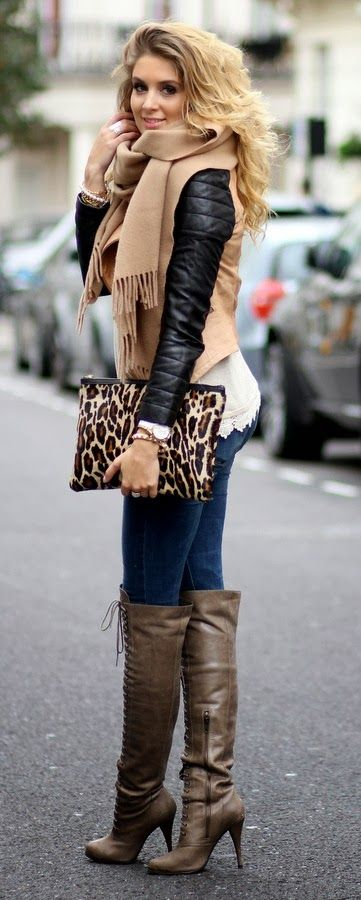 Lovely winter fashion look with scarf, jacket and laceup long boots: