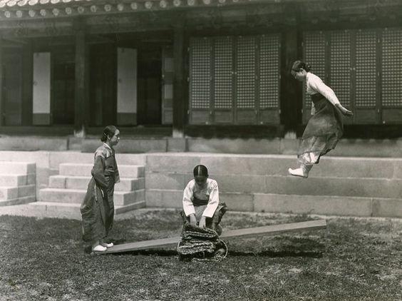 Seesaw, Korea  Photograph by W. Robert Moore, National Geographic    This Month in Photo of the Day: Vintage National Geographic Photographs    Young women play on a seesaw in Korea in this 1931 image.    As chief of the foreign editorial staff at National Geographic, photographer W. Robert Moore had a hand in nearly 90 magazine articles. He retired in 1967.