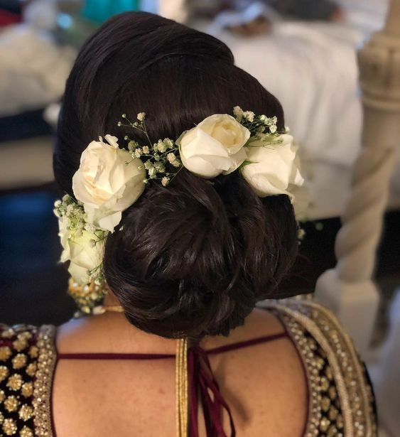 Indian Wedding Bun Hairstyle With Flowers And Gajra Indian Wedding Hairstyles Low Bun Wedding Hair Indian Bun Hairstyles