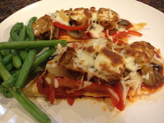 Low-Carb Chicken Pizza: By losing the dough and using thinly pounded chicken as the crust, I put my own low-carb spin on traditional pizza. Pile on sauce, veggies, and cooked turkey sausage for a zesty, low-cal splurge! A perfect pizza alternative for those with type 2 diabetes.