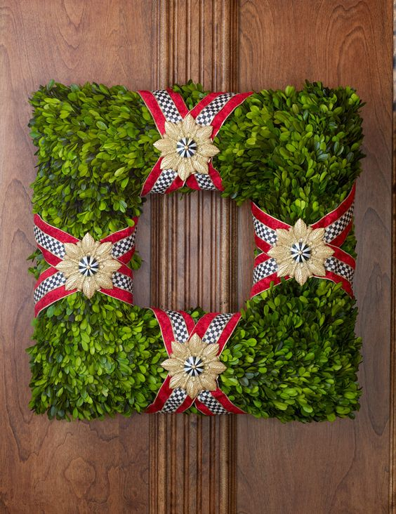 Crisscross Courtly Check ribbon with glittering gold medallions and MacKenzie-Childs embellishments adorn this preserved boxwood wreath. Classic! .#Christmas