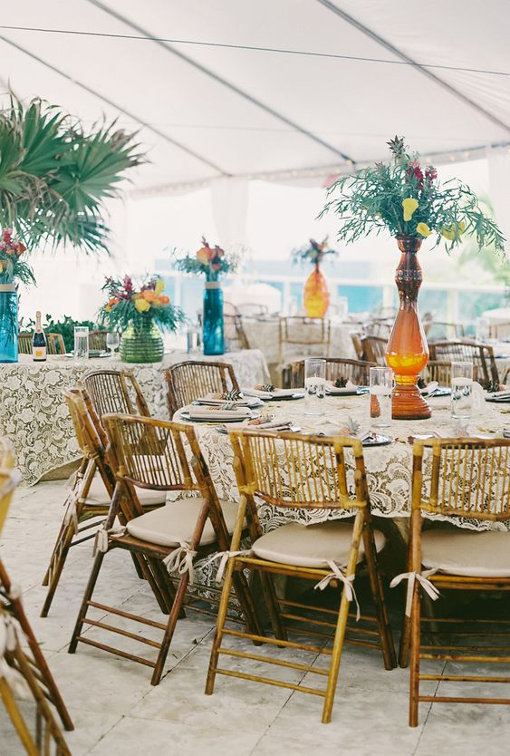Tall Tropical Reception Centerpieces | Photo: Ian Joseph Jones Photography |