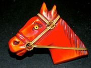 SALE SUPER SALE Red Bakelite horse head pin with metal bridle and glass eye!