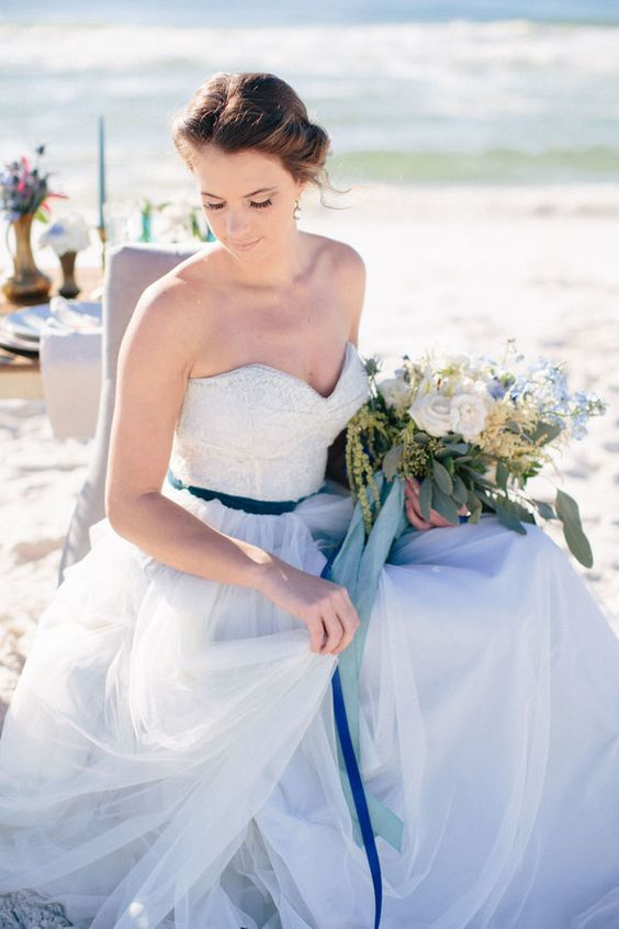 The navy belt on this Rebecca Schoneveld pastel wedding dress is the perfect nautical bridal accessory. This is perfect for the bride that wants to feel like a princess even at her beach wedding.