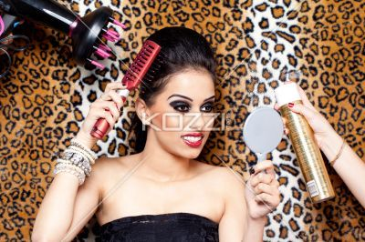 young indian woman getting ready for a shoot. - Image of a Indian female fashion model getting ready for the shot, Model: Kiran Bahugun