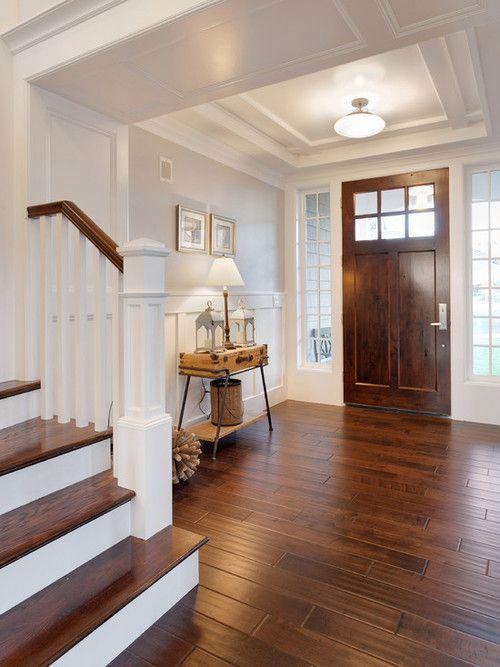 Inside entry, wood door, wood floors, wood stairs