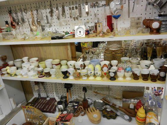 Shelf full of vintage egg cups