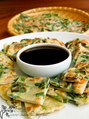 """""""Pa-jeon – Traditional Korean savoury pancakes:""""  (Korean Seafood & Spring Onion pancakes)  From blog post:  """"Now this dish is by far one of my all-time favourite snackfoods, with its fried frittery goodness which contains the mild oniony goodness of spring onions, the flavour of the sea all dipped into a simple soy & vinegar sauce to combat the oilyness, its a way of enjoying pancakes that I know not many people have had the luck to try!"""""""