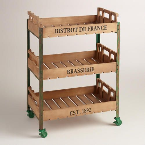 With its green distressed metal frame and apple crate-inspired baskets, this rolling storage cart has the rustic, old-world look of a vintage Parisian find. >> #WorldMarket Storage and Organization