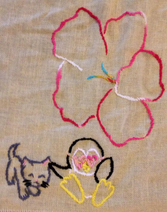 Detail of hand embroidered tablecloth (tablecloth is 5' x 10').  Tablecloth was a wedding gift to my brother & sister in law.  Each penguin represents a member of their family, the wedding was a hawaiian themed wedding. xoxo  www.Etsy.com/shop/jenEembroidery