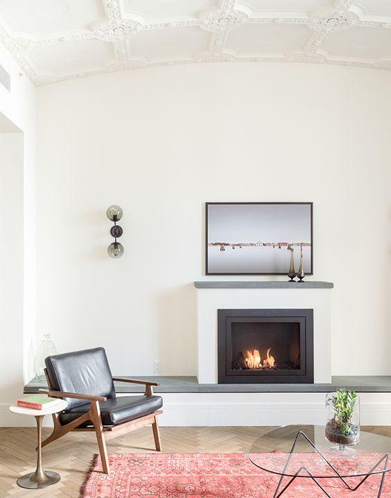 a minimal living room with herringbone floors, modern fireplace, beautiful molding on the ceilings | coco+kelley