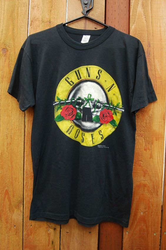 Vtg 80's Guns n Roses Concert T-Shirt. $92.00, via Etsy. And to think I had this shirt when I was 12 years old!!  I should have held on to it!