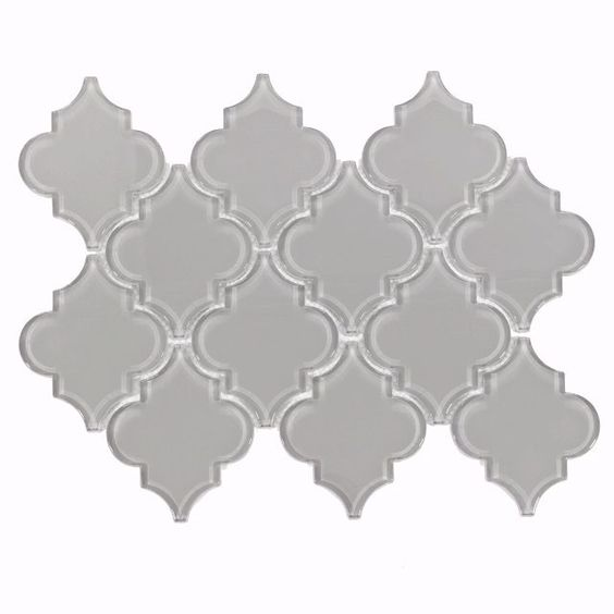Play with gray! Accessorize with different shades for depth or add a memorable mosaic for touchable texture.