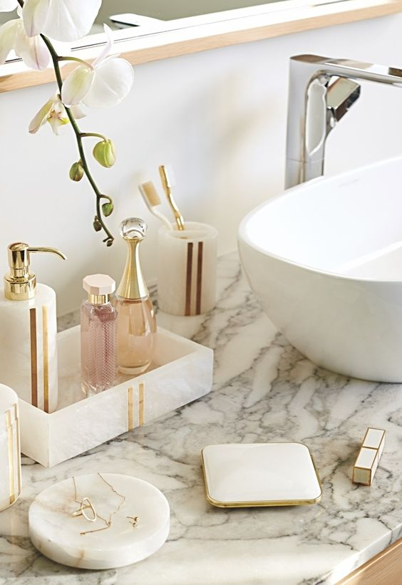 Crafted of opulent, natural alabaster, the Esme Alabaster Collection is unadulterated beauty. Intrinsic variations in the grain and color of the semi-translucent stone ensure each piece will be unique. Linear brass accents enhance the aesthetic value.