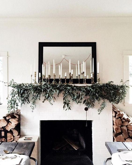 white tapers with eucalyptus garland