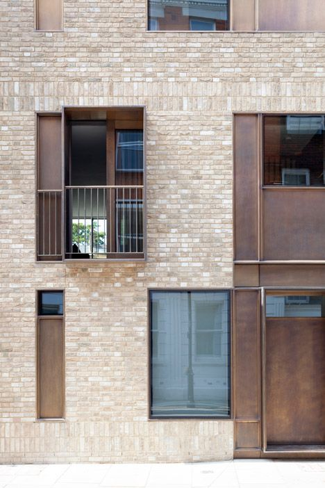Brick and bronze paired for contemporary house on a historic London street