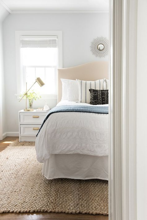 Calming Bedroom with jute rug and white bedding