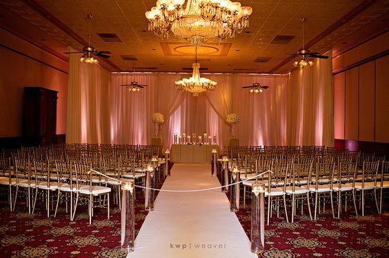We loved how our golden chiavari chairs looked under pink up-lighting at Chelsea and Adam's ceremony. What color lighting would you combine with our chairs? Picture by Kristen Weaver Photography.