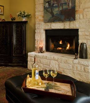 A glass of wine, a warm fireplace, a cozy loveseat... Find them all at Blair House Inn, a bed & breakfast in Texas Hill Country.