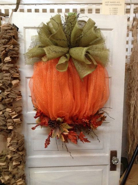 This one of a kind mesh pumpkin wreath will surely greet all your friends and family this fall! Made on a metal frame with mesh, burlap, pine
