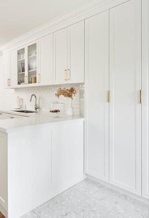 Thin Brass Pools On A White Shaker Cabinet Kitchen Design With White Beveled Subway Tile White Beveled Subway Tile Kitchen Cabinet Design White Shaker Cabinets