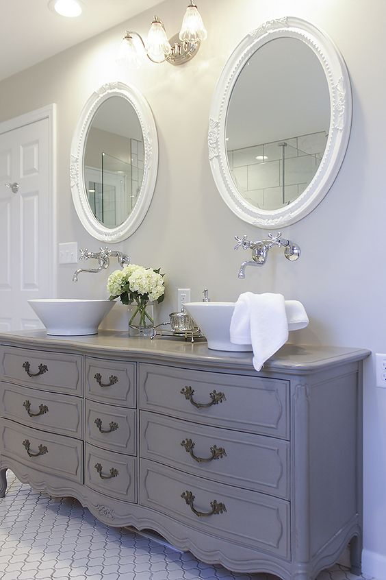 Vintage french dresser turned into a double sink vanity. ShadesOfBlueInteriors Blog. Come check out Antique Vintage Style Bathroom Vanity Inspiration! #bathroomdesign #bathroomvanity #classicstyle #traditionaldecor #interiordesignideas