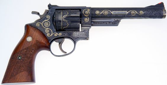 Smith & Wesson 44 magnum... my favorite engraved gun. Luv the gold scrolls and the carved wooden handle