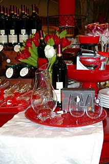 Valentine display with chocolate, wine, and red pottery