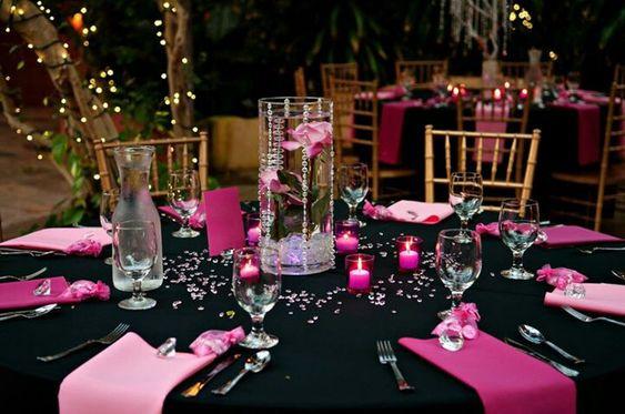 Pink and black wedding reception decor