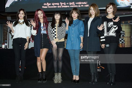 Members of South Korean girl group T-ara pose for media at their 8th Mini Album 'Again' record release signing at IFC Mall on October 27, 2013 in Seoul, South Korea.
