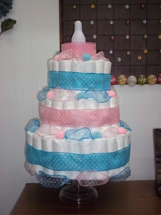 Diaper cake!! For my friend Jerrica, for her 'reveal party'...girl or boy? Another great idea from pinterest.