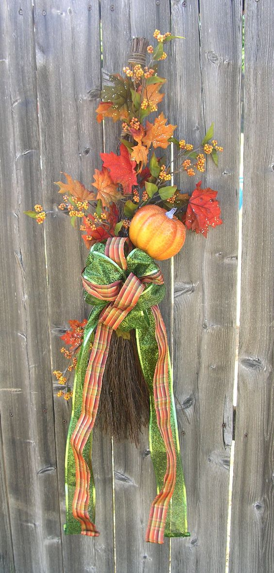 Use cinnamon broom from dollar store. Different bow color. Harvest Door Decoration with Pumpkin
