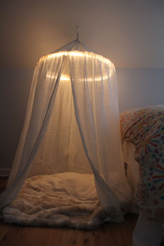 """A perfect canopy - This is easy to make using a hula hoop for the frame and rope lighting to create a """"halo effect."""""""