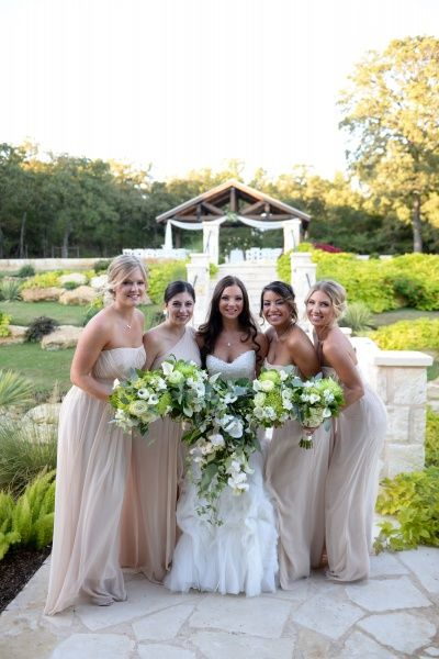 Beautiful neutral bridesmaid dresses with gorgeous greenery and ivory bouquets.  Love this rustic, outdoor wedding look.  Outdoor ceremony, the south, southern wedding, beautiful, bridesmaid, bridesmaid dresses long, bridesmaid bouquets, bridesmaids.