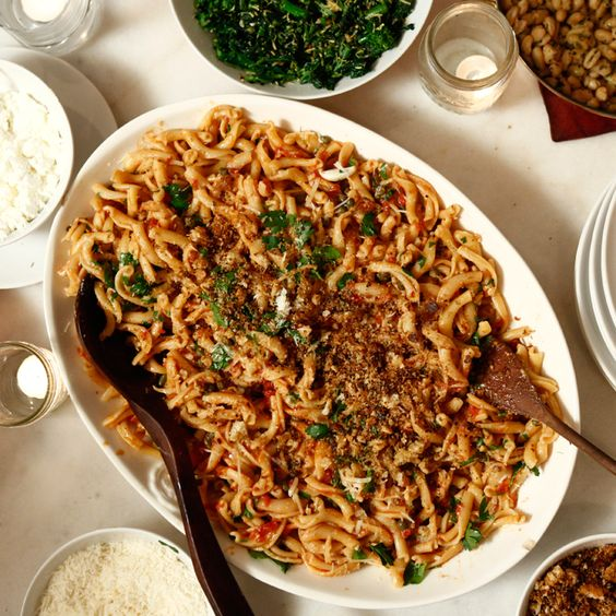 "The after-party Italian tradition of spaghettata di mezzanotte—""midnight spaghetti""—gave birth to this lusty pasta dish tossed with anchovies, capers, tomatoes, and garlicky bruschetta crumbs."