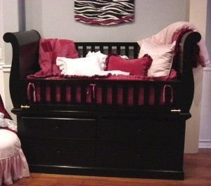 beautiful crib with drawers underneath.