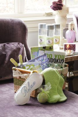 Create a  gift basket for out of town guests (have in hotel room)