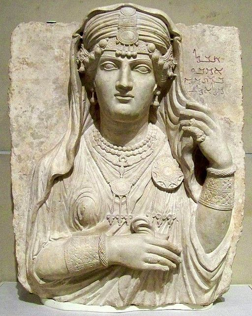 "Stele from Palmyria in the Roman province of Syria, about 200 CE The Aramaic inscription is, ""Alas, Umm'abi, daughter of Maggi, son of Male, son of La'ad"". The linear style of carving and the clothing and jewelry reflect local fashions. The sculpture was once painted: the jewely shows traces of red, blue, green, and yellow pigment."