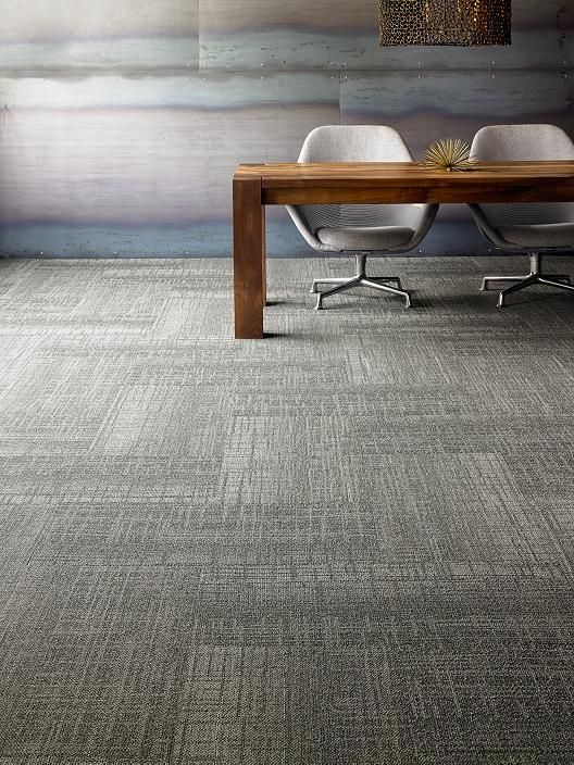Achieve a simple, understated elegance with grey carpet tiles
