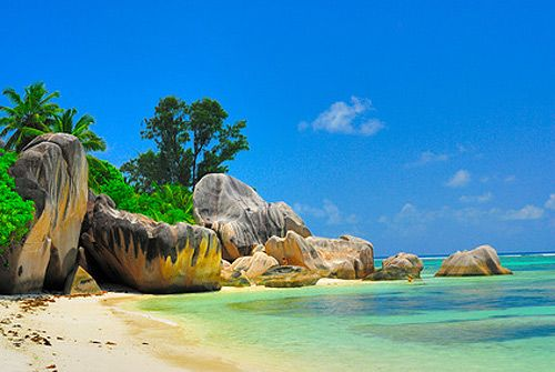 La Digue, The Seychelles. This paradise island lies in the Indian Ocean and attracts many honeymooners every year. Typical to this island are granite rock formations which create stunning contrast with white sand beaches and turquoise blue sea.