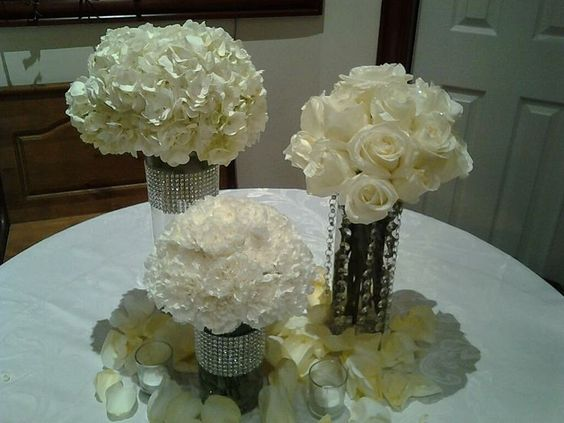 Wedding centerpiece of white roses, white hydrangea and white carnations