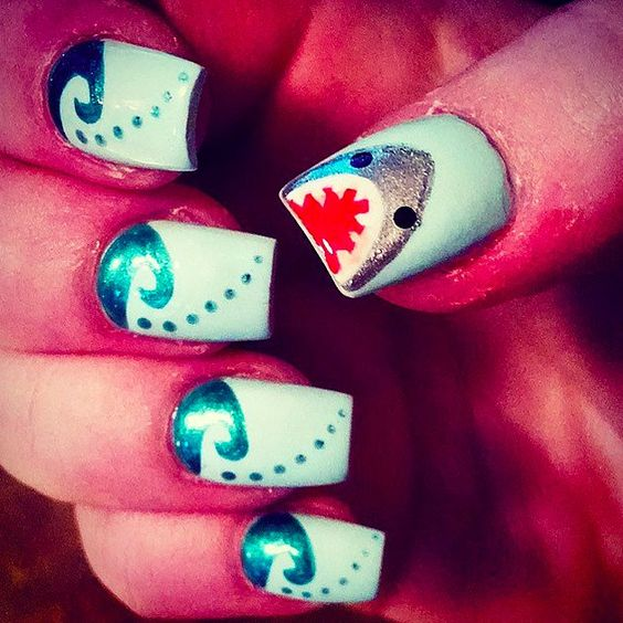 21 Terrifyingly Cool Shark Week Nail Art Looks: We live for any holiday that gives us an excuse to go all out on our nails —Independence Day, St. Patrick's Day, Valentine's Day, the list goes on — but a whole week is really worth commemorating on your claws.