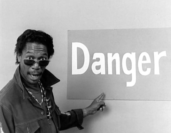 """""""The Electric Company"""" promo still, circa 1972.  Morgan Freeman as Easy Reader.  Freeman had recurring characters like DJ Mel Mounds, a vegetable eating vampire, and other roles.  His best known character was this one - a hip guy who could make the ingredients off a candy bar read like poetry."""