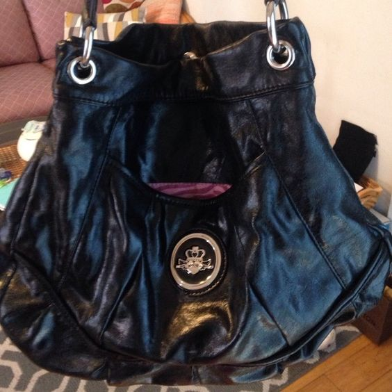 Kathy Handbag Excellent condition inside and out two outside pockets 4 inside pockets Kathy Van Zeeland Bags Satchels