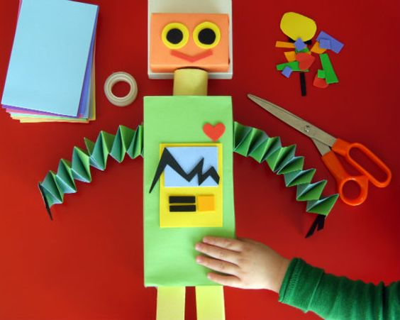 Recycled Robot makes from recycled boxes, construction paper and foam sheets. I used paper towel tubes as arms and filled them with cut up straws and confetti.  Blow from the other end to create fun missiles and confetti explosions :)