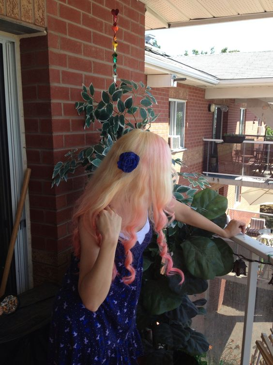 Cotton candy by Manic Panic swirled into the bottom of my hair. (Never dying the top again)  bleached hair again to get rid of the rest of the hot hot pink. Sectioned off my hair into 8 high ponytails on my head and work backwards from the last pony forward, one side at a time twirling the sections while running the pink through. Make the ends thicker with colour and loosely at the top. Let sit for 1 1/2 hours for stronger colour stay. Always rinse in cold water and condition!!!
