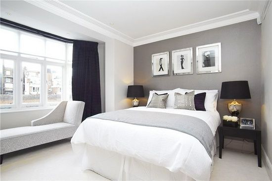 White and grey bedroom. Love the silver picture frames.