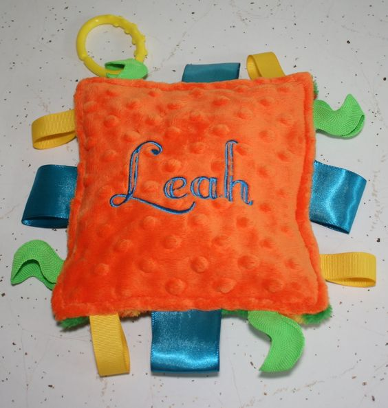 Taggie toy.....make sensory ones out of rice, beans, crunchy sounds, squeekers.